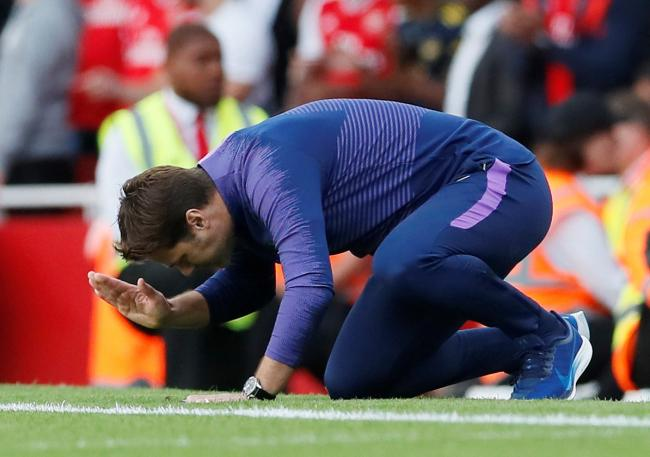 Mauricio Pochettino hits the ground in frustration. Picture: Action Images