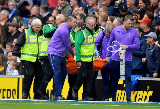 The Tottenham keeper is stretchered off following his injury. Picture: Action Images