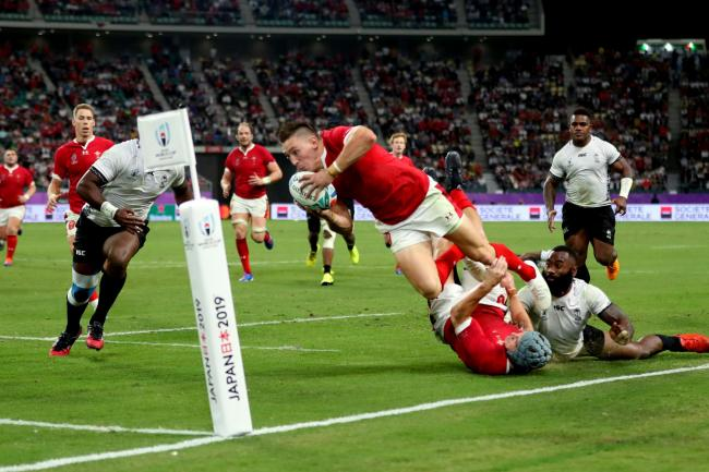 Wales wing Josh Adams dives over for his third try against Fiji
