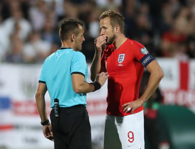 Harry Kane speaks to referee Ivan Bebek during the match. Picture: Action Images