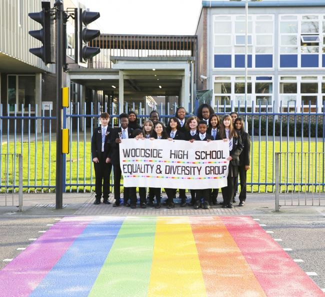 Woodside High School of pupils standing by a rainbow-coloured road crossing. Photo: Woodside High School/PA Wire