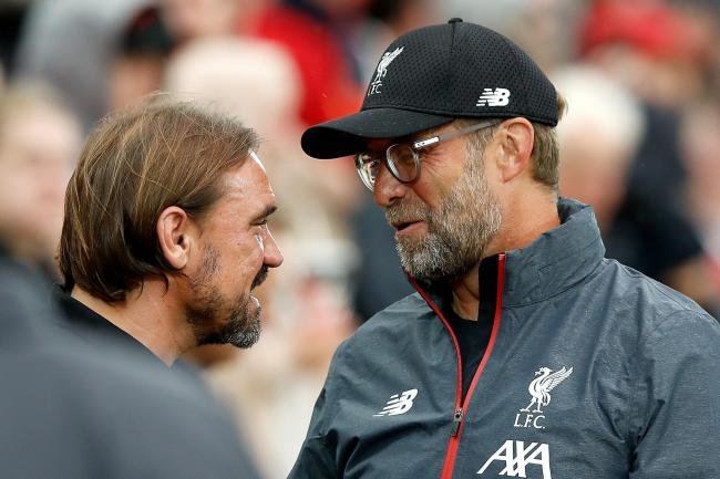Daniel Farke (left) will be out to get the better of fellow German Jurgen Klopp at Carrow Road