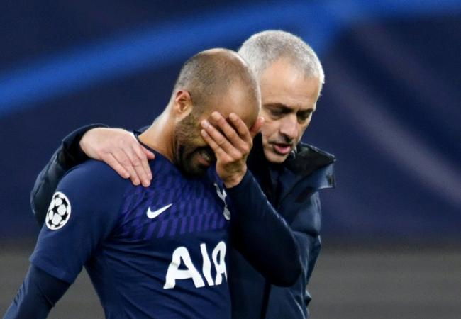 A dejected Lucas Moura is comforted by Jose Mourinho following the defeat. Picture: Action Images