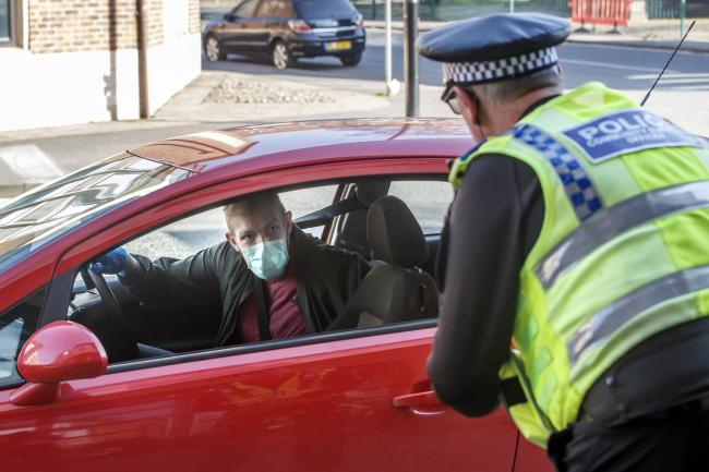 Police check motorists are complying with Government restrictions