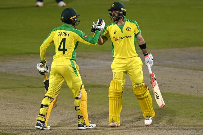 Maxwell (right) and Carey both scored centuries