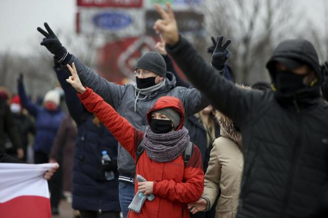 Demonstrators wearing face masks during an opposition rally in Minsk