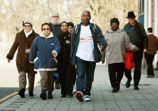 Walk of life: Haringey residents join volunteer walking group leader Colin Campbell, 69, for some much-needed exercise