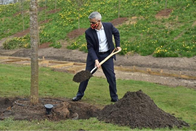London Mayor Sadiq Khan helped finish the memorial garden. Credit: PA