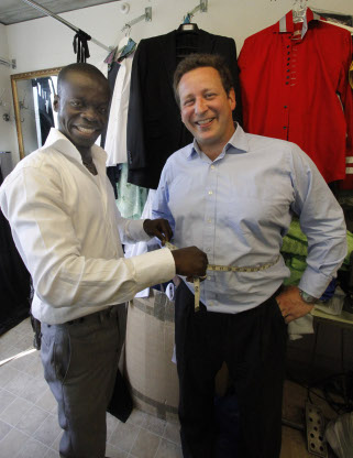 Suits you, sir: fashion designer Osei Asibey Bonsu measures culture minister Ed Vaizey MP