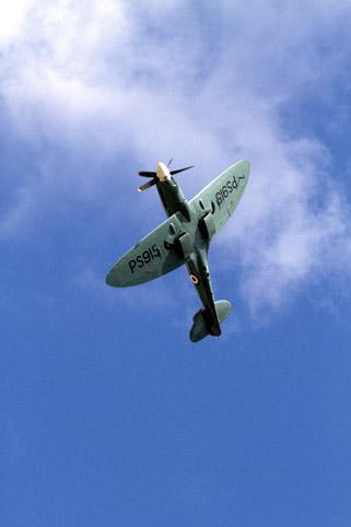 A Spitfire flies over Hendon for the Battle of Britain Memorial Flight