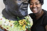Gina Moffat with a bust of Bernie Grant