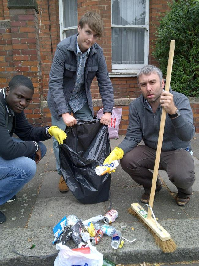 Cllr Richard Wilson (right) in Mark Road, Wood Green, with volunteers clearing up litter