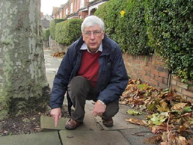 Cllr Jim Jenks by a broken pavement in Priory Avenue in Muswell Hill