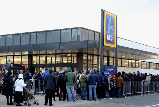 Supermarket destroyed in riots back in business