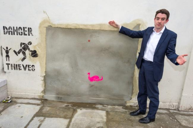 Cllr Alan Strickland at the Whymark Avenue wall from which the Bansky was taken
