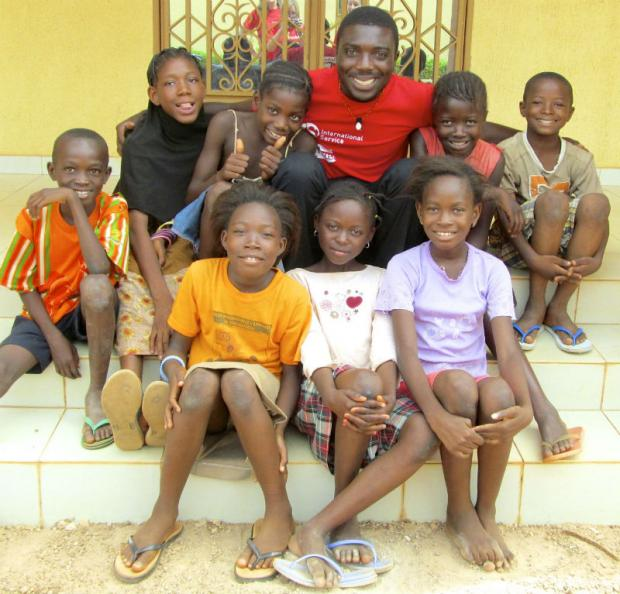 Kwame Asiedu and school children in Burkina Faso