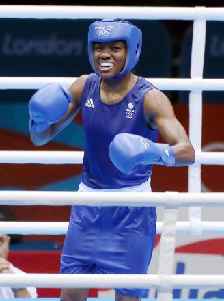 Nicola Adams is through to the Commonwealth Games semi-finals: Action Images