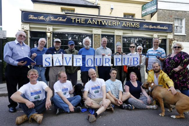 Members of the Antwerp Arms Association outside the Antwerp Arms