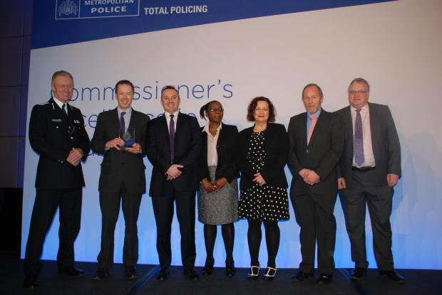 Members of the trust and Metropolitan police collecting their award