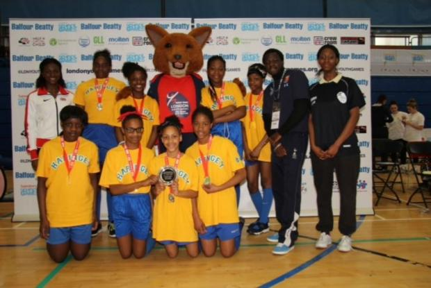 St Thomas More Catholic School's winning Year 7 team with GB sprinter Dina Asher-Smith (far left)