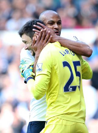 Younes Kaboul (left) congratulates Hugo Lloris (right) after his penalty save against Fulham last weekend. Picture: Action Images