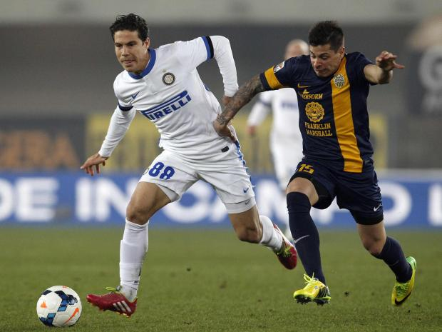 Juan Iturbe (right) takes on Inter Milan's Hernanes (left). Picture: Action Images