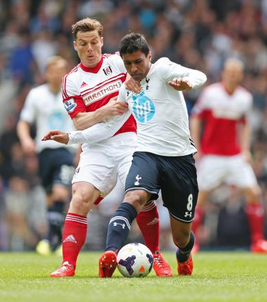 Paulinho battles with Fulham's Scott Parker. Picture: Action Images