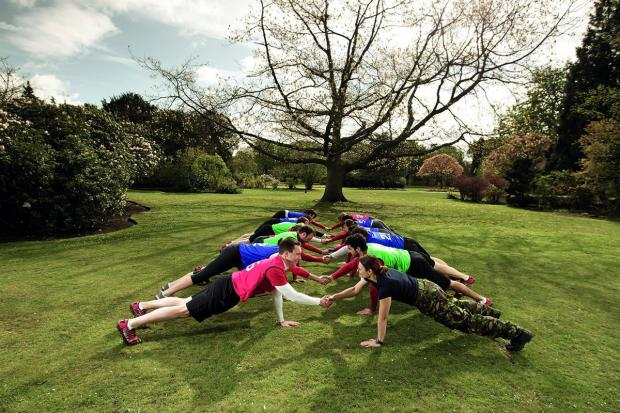 A group are put through their paces in a military fitness class