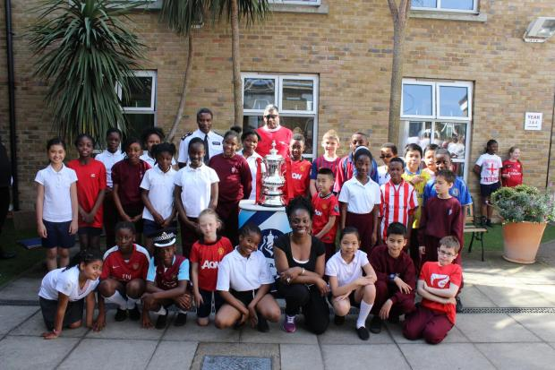 Tottenham Independent: Children are photographed with the FA Cup.