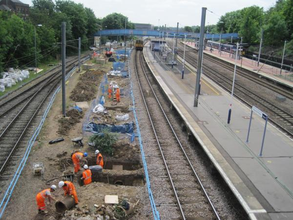 Network Rail workers lay new tracks through the borough