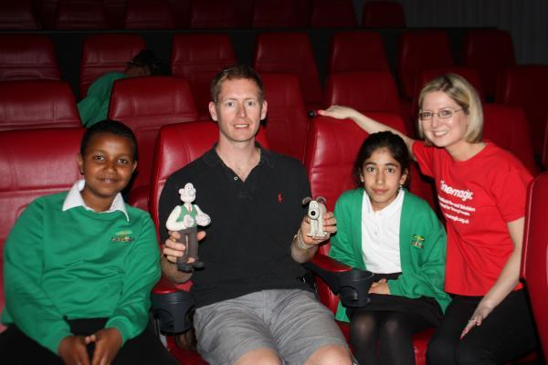 Merlin Crossingham with pupils Zilan Egribayir and Zaki Isse
