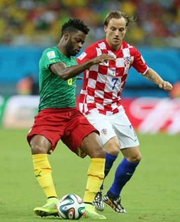 Alex Song (left) challenges Croatia's Ivan Rakitic at the World Cup. Picture: Action Images