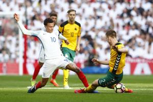 Dele Alli goes into a challenge in England's World Cup qualifying win over Lithuania on Sunday. Picture: Action Images