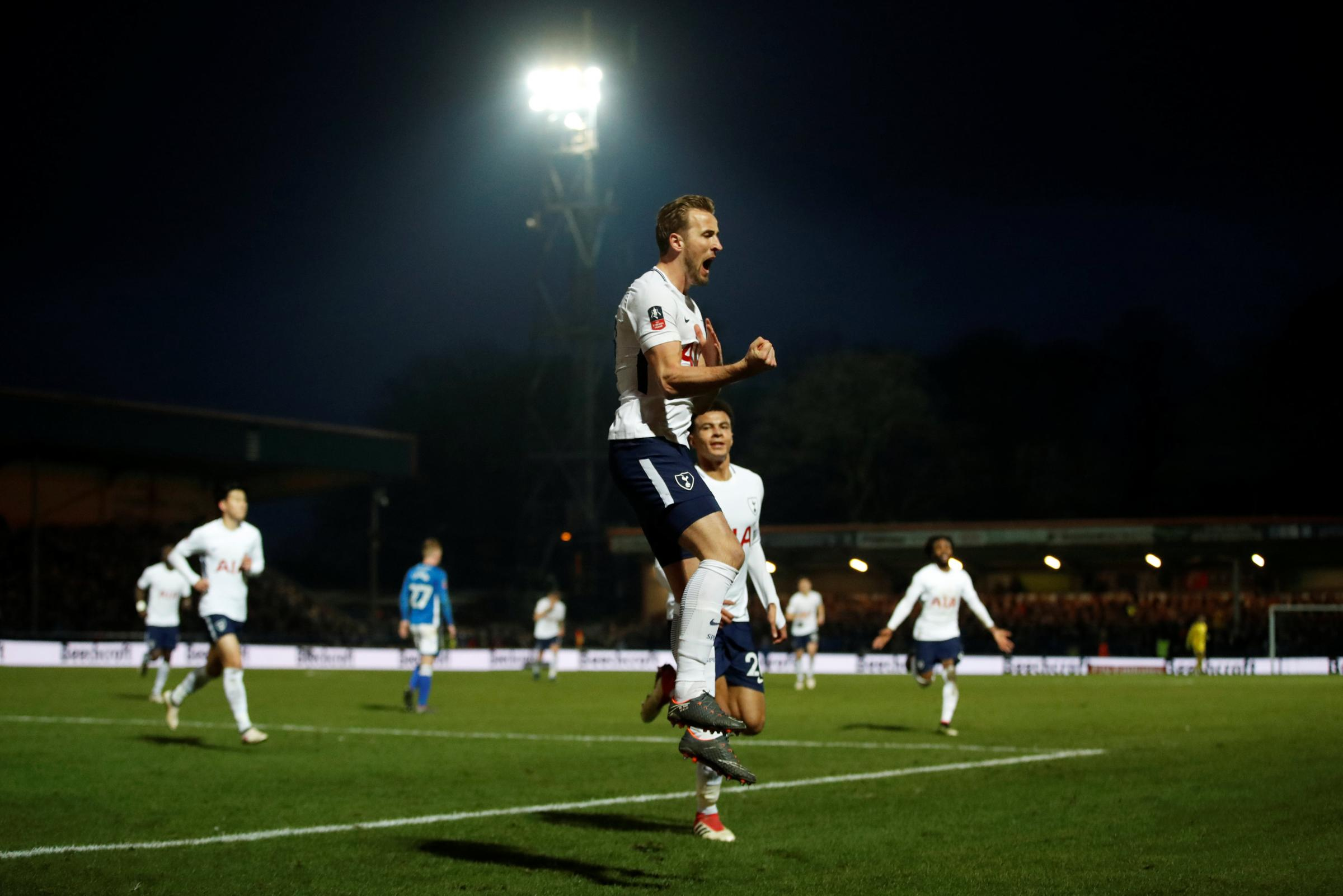 Harry Kane celebrates giving Spurs the lead yesterday, but they were to be pegged back in injury time by Rochdale. Picture: Action Images