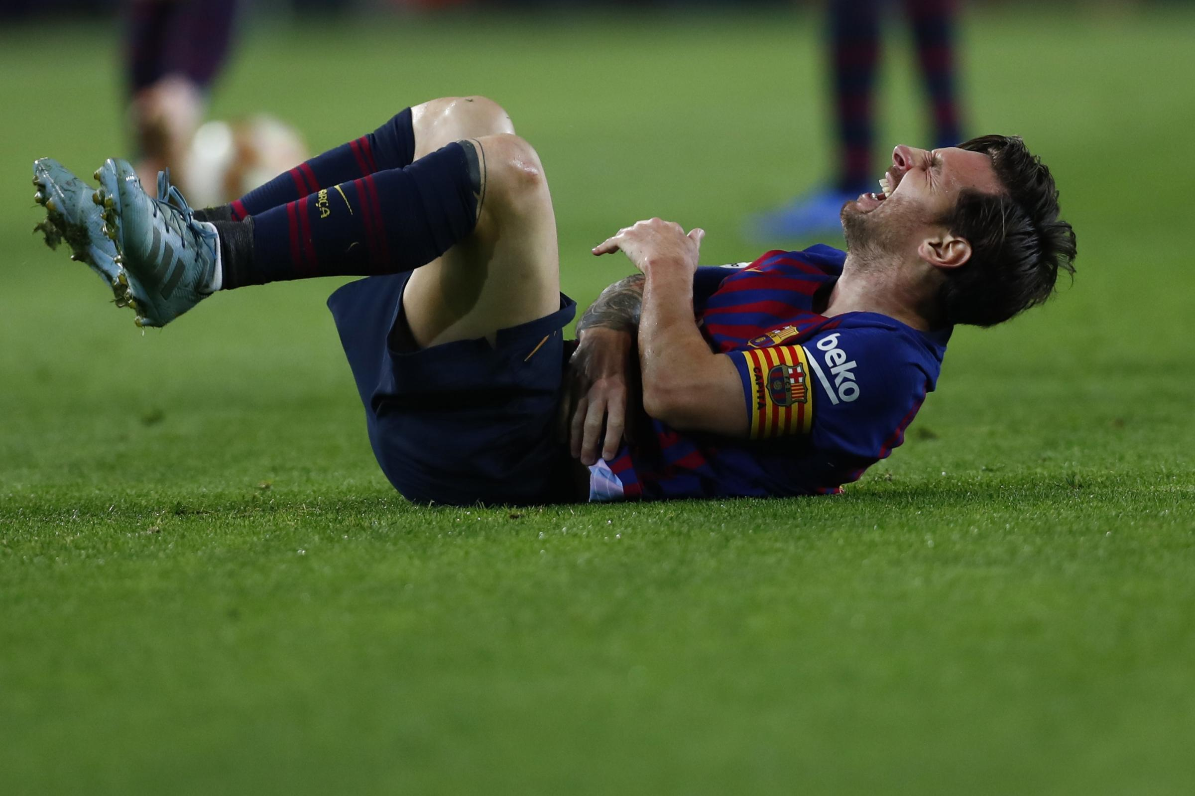 Lionel Messi has been ruled out for three weeks with a fractured forearm (Manu Fernandez/AP).