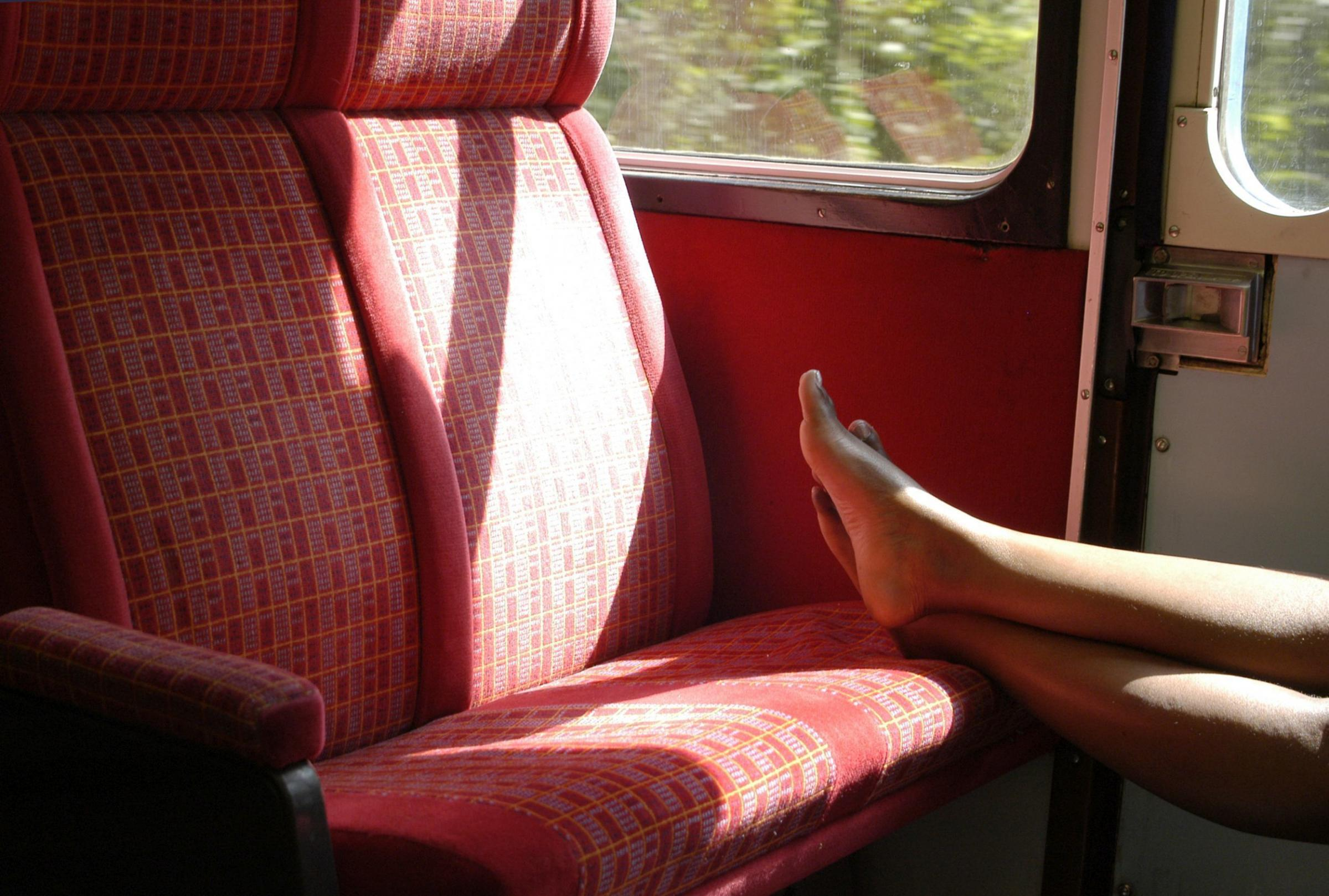 Why do people put their feet up on train seats?
