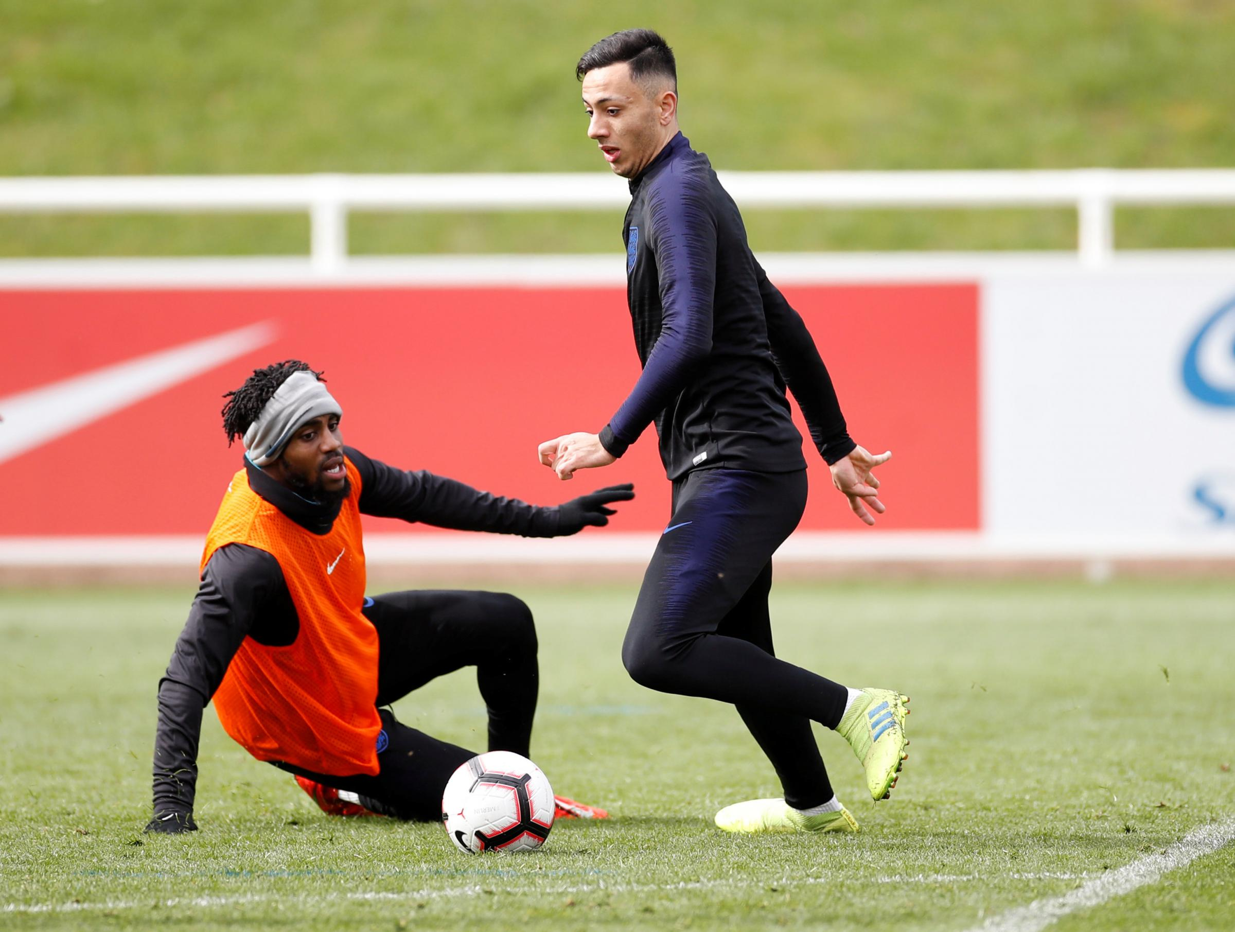 Danny Rose and Burnley's Dwight McNeil in England traning. Picture: Action Images